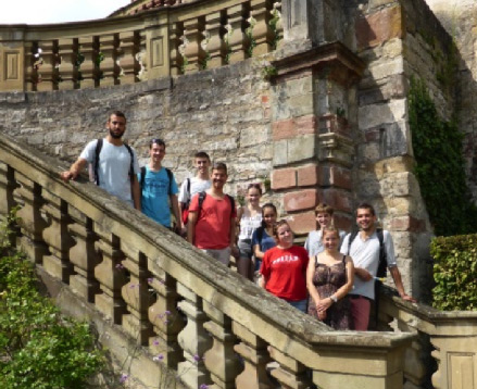 The team on a stairwell at the castle